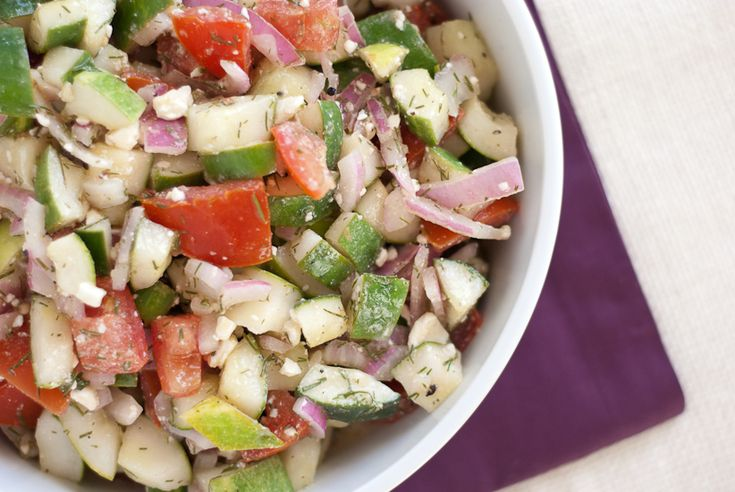 salad made of cucumber, tomato, dill and feta