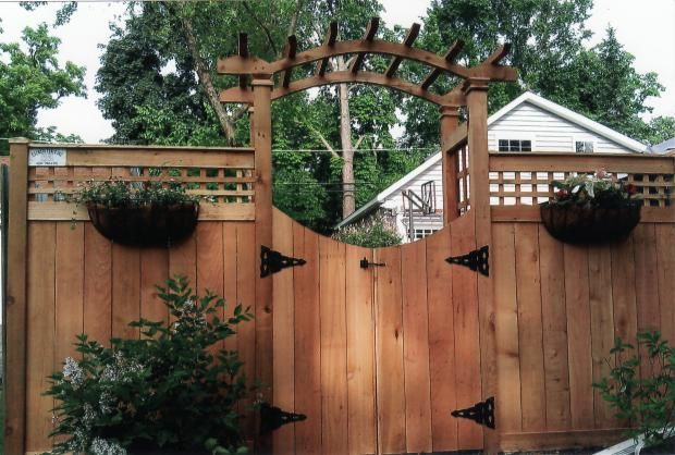 Traditional trellis iron wood fence mounted planters