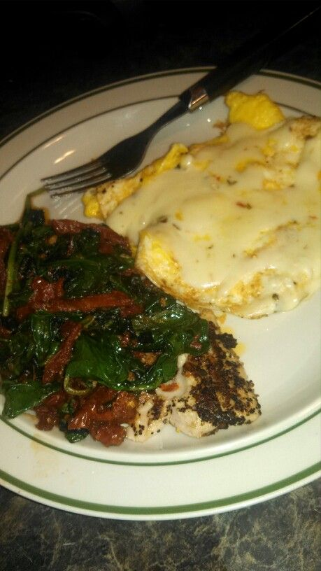 Grilled tilapia with garlic, spinach, and tomatoes. Scrambled eggs ...