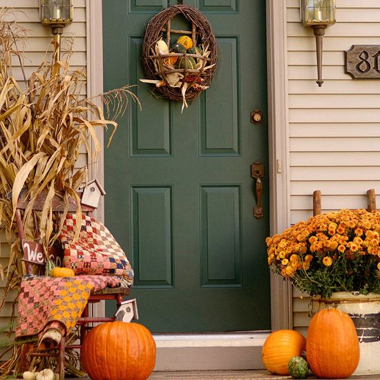 Mums and cornstalks give this entrance autumn style. More pretty fall front doors: http://www.bhg.com/halloween/outdoor-decorations/pretty-front-entry-decorating-ideas-for-fall/?socsrc=bhgpin092012cornstalkentry=14