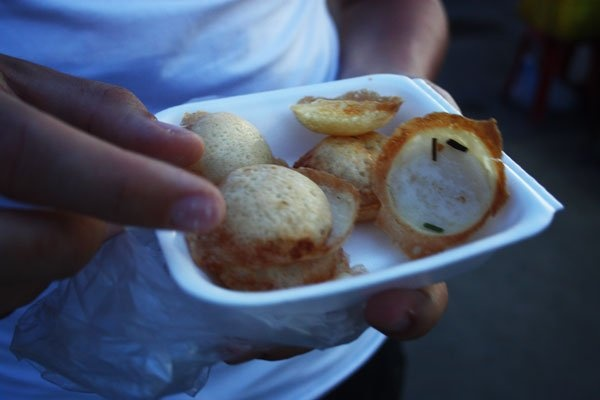 Khanom krok. Coconut griddle dumplings. A savory pancake mixture is ...