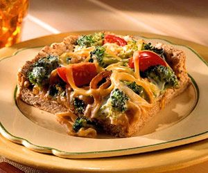 Top a homemade whole wheat pizza crust with broccoli-alfredo sauce ...