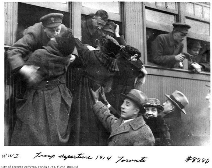 Soldiers kiss loved ones goodbye as they prepare to depart Toronto's Exhibition Camp for the battle overseas in 1914. Feb. 5 is the International Kissing Day, reports Citron