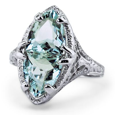 The Poseidon Ring - a bold Art Nouveau ring with two natural brilliant cut aquamarines   brilliantearth.com