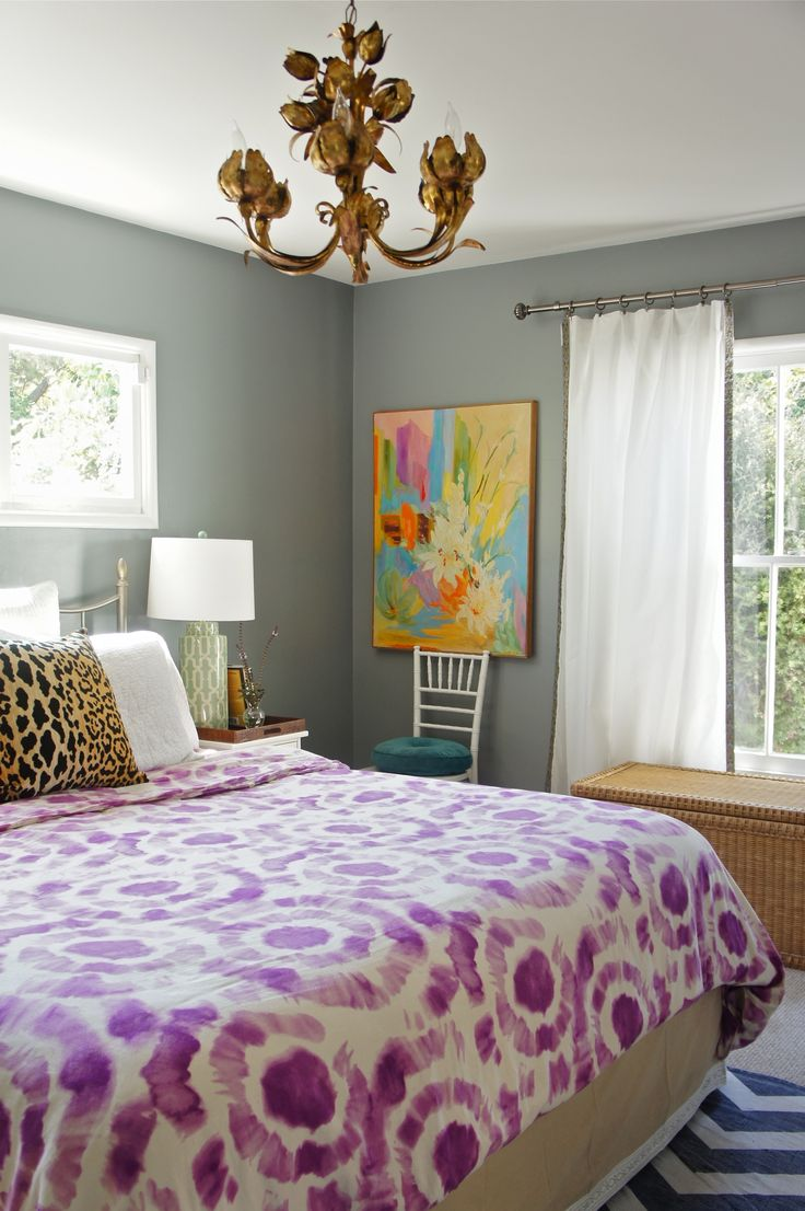 tye die bedspread, leopard pillow, brass chandelier, colorful art, chiavari chair