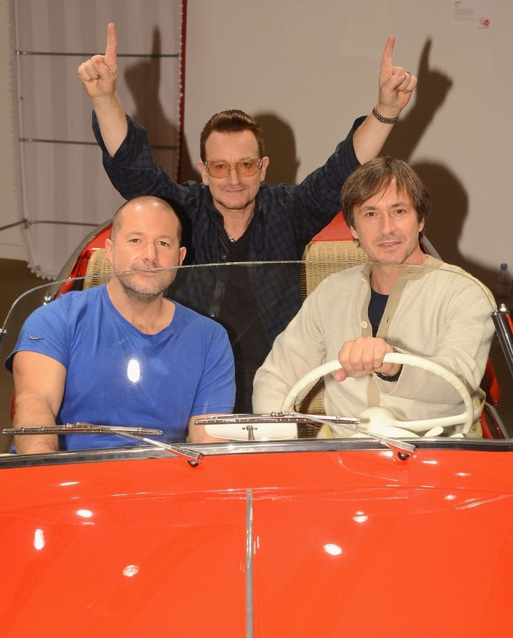 Designers Jonathan Ive and Marc Newson take U2's Bono for a spin in a red Fiat 600 Jolly before its put up for auction by Sotheby's (RED) Auction in New York on Nov. 21