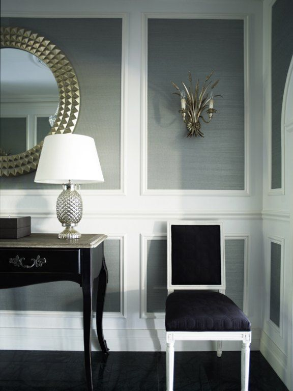Foyer - Wall molding inlaid with metallic grass cloth elegantly sharing the space with a classic side chair, antique console table and silver framed round mirror.  Sophisticated elegance.     (repinned photo only from Greg Natale - Sydney based architects and interior designers)