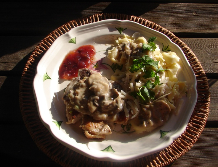 Pork Chops in a cream sauce with sauteed mushrooms & shallots served ...