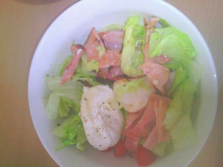 Poached eggs bacon lettuce and cherry tomatoes