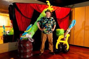 Friday, July 25 - Balloonosaurus! by Jungle Jim. Through his balloon art, Jim will construct a gigantic dinosaur made out of balloons while leading the children through the fun parts of paleontology.