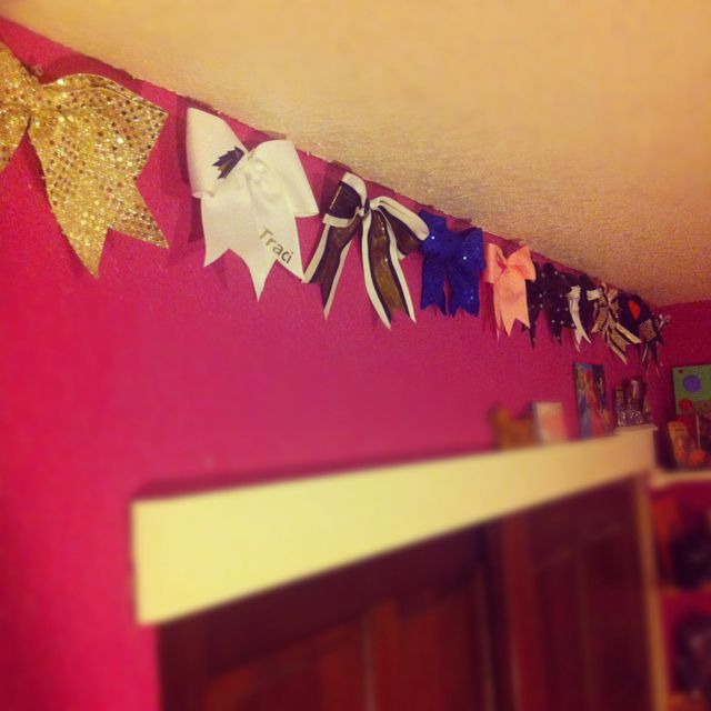 Old cheer bows hung on the wallif I ever have a girl