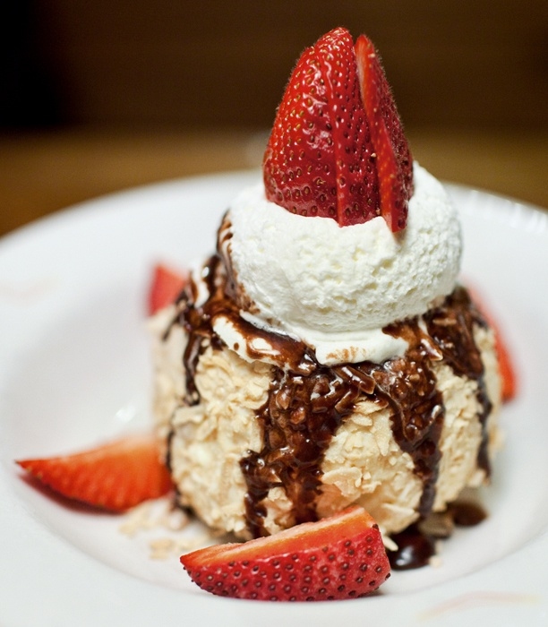 ... coconut and topped with chocolate sauce, whipped cream and a fresh