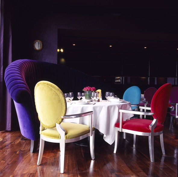 Random coloured chairs in the dining room at the G Hotel, Galway