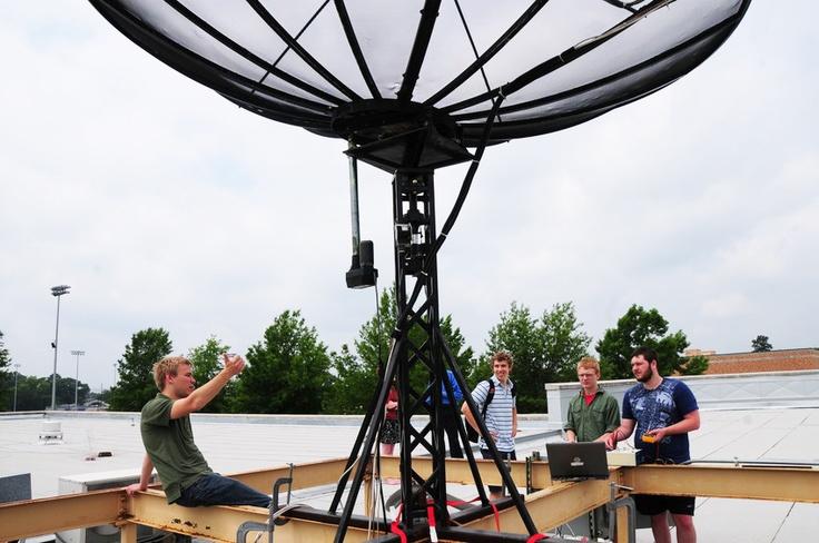 Fixing a radio telescope on the roof of Glaske. http://www.letu.edu/