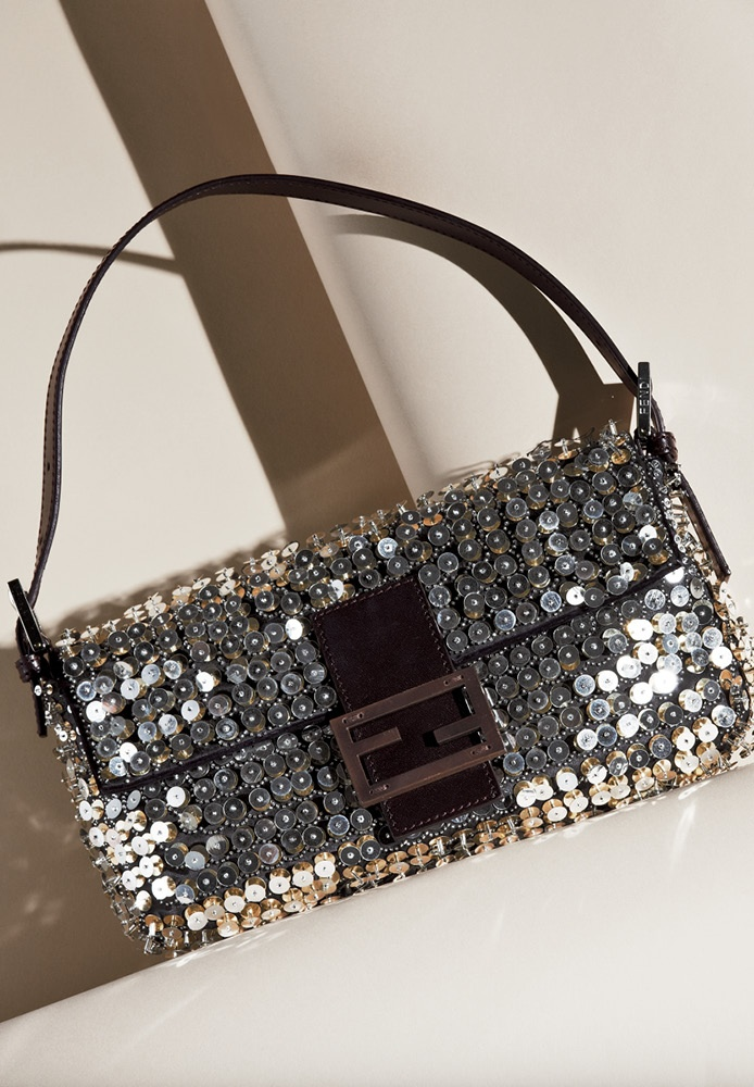 An iconic design with an innovative three dimensional style in luxurious leather accented with sparkling sequins and beads.