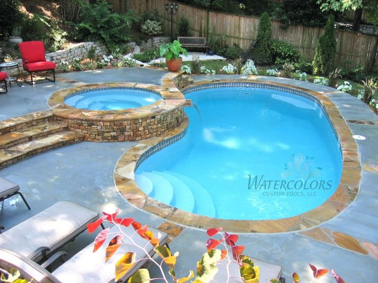 Fiberglass swimming pool with raised spa patio pool for Raised swimming pool designs