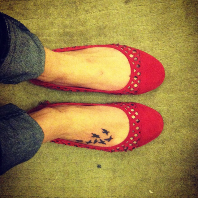 Bird foot tattoo