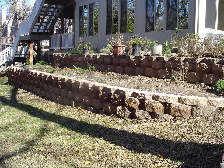 Retaining wall planter garden wall pinterest for Retaining wall plants landscaping