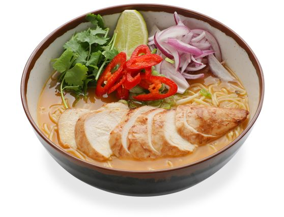 chicken ramen noodles in a spicy chicken soup topped with chicken ...