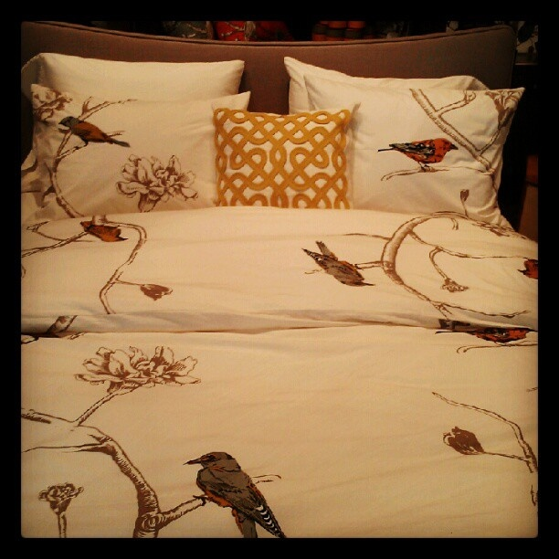 A pop of citrine on our Chinoiserie duvet set at #77Wooster via @lipstickfashion