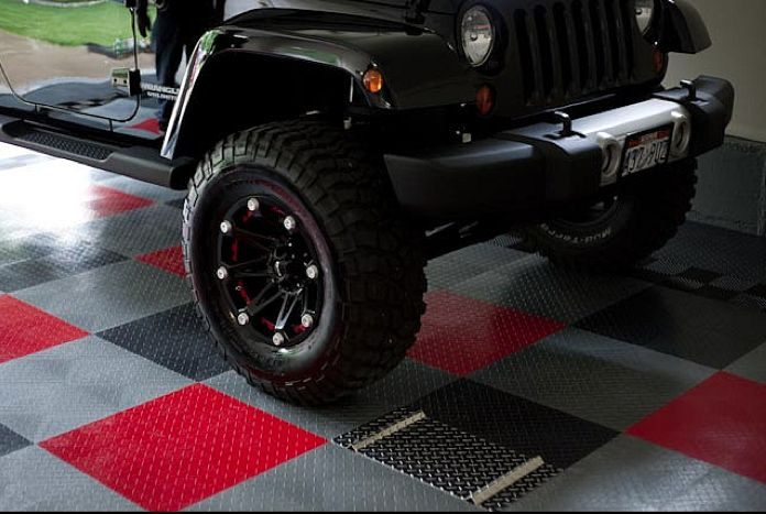 Racedeck garage flooring under this cool jeep http www for Cool garage floors