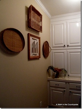 wicker trays as art work in the china closet
