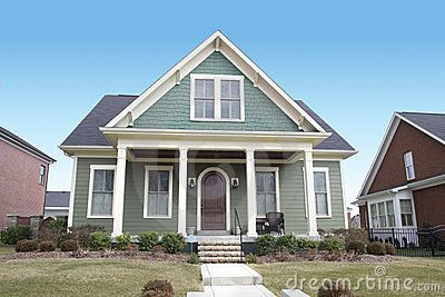Green cape cod style house paint color exterior color for Cape cod style house colors