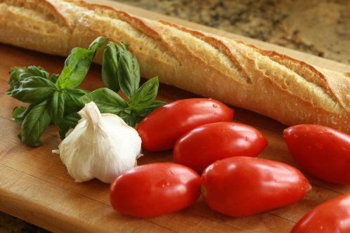 Tomato, basil & goat cheese bruschetta. (Yup, must be great: she rubs ...