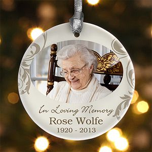 "What a beautiful way to remember someone you lost this year ... it's the ""In loving memory"" personalized photo ornament from PMall - you can add your own photo and any message. This is beautiful"
