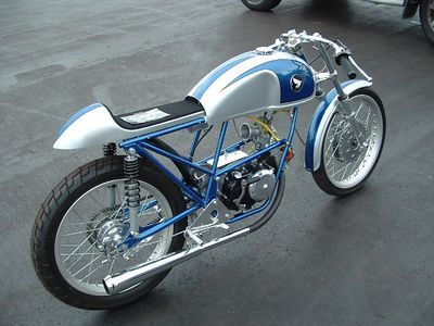 Tiny honda with a really unusual, well-executed blue & silver paint scheme