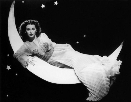 Hedy Lamarr on a crescent moon.