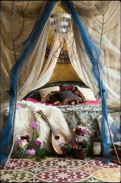 Music.  Boho deco.  Creative chandelier.  Flowers.  Lots of pillows. Faux fur throw. Perfect spot.