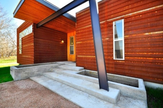 Love the weathered look of this corrugated steel siding.  Beautiful prefab out of Ma Modular in Austin.