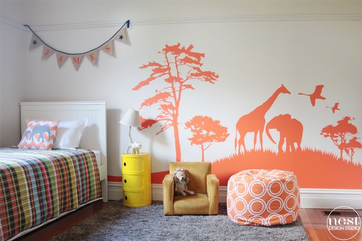 Safari-Inspired Boys Room with Orange Wall Decal - what a great big boy room!