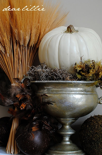 Wheat, white pumpkin and moss in silver urn