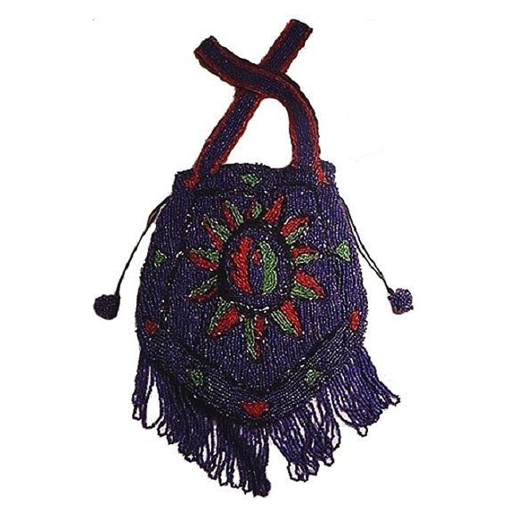 Antique beaded cobalt blue fringed handbag.