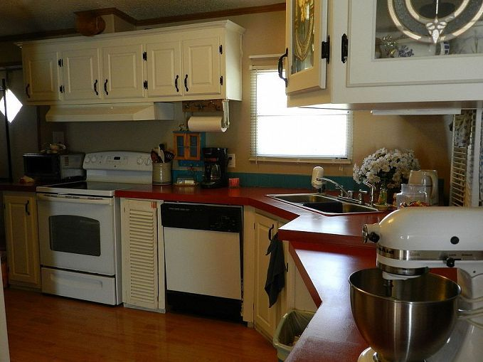 Painting particle board cabinets in mobile home for Painting particle board kitchen cabinets