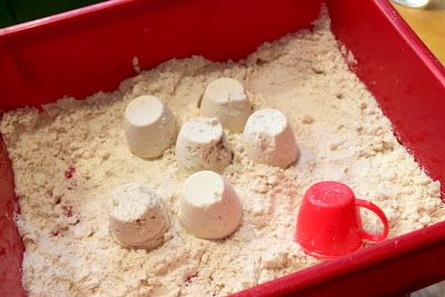 Cloud Dough - 8 cups flour & 1 cup baby oil.  It feels like flour as you run your fingers through it, but it's moldable.