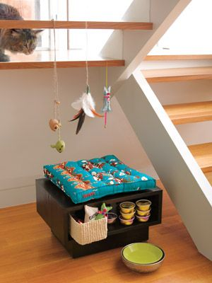 A pet bungalow under the stairs! Such a great idea!