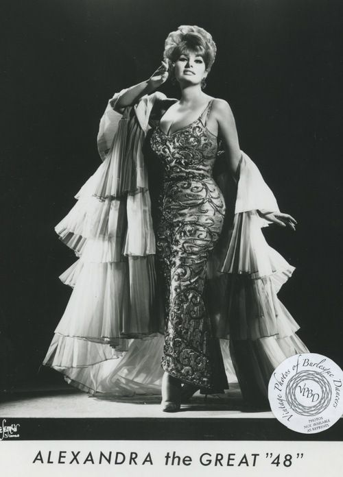 """Alexandra the Great 48"""" (Gerri Weise): vintage 8x10 photo. Alexandra was a protege of Rose la Rose.Rose worked with her to develop and act, and in return Alexandra would work at Rose's club, the Town Hall, in Toledo, Ohio, while she developed her act.Alexandra would frequently return to work at Rose's theater and the two remained friends until Rose's death in 1972."""