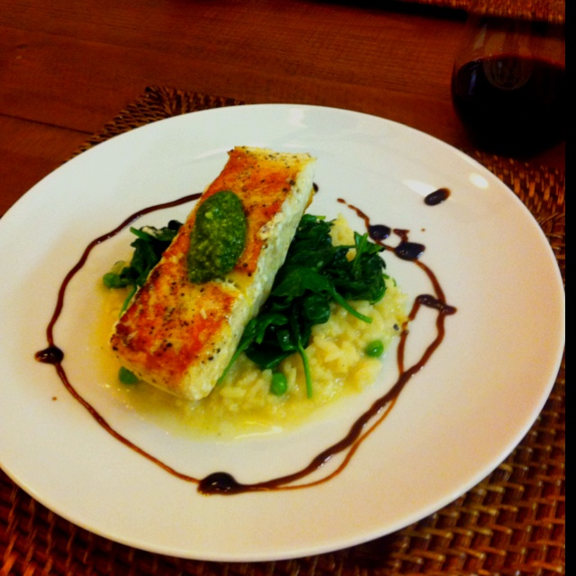 Pea and parmesan Risotto, sautéed spinach, pan seared halibut with ...