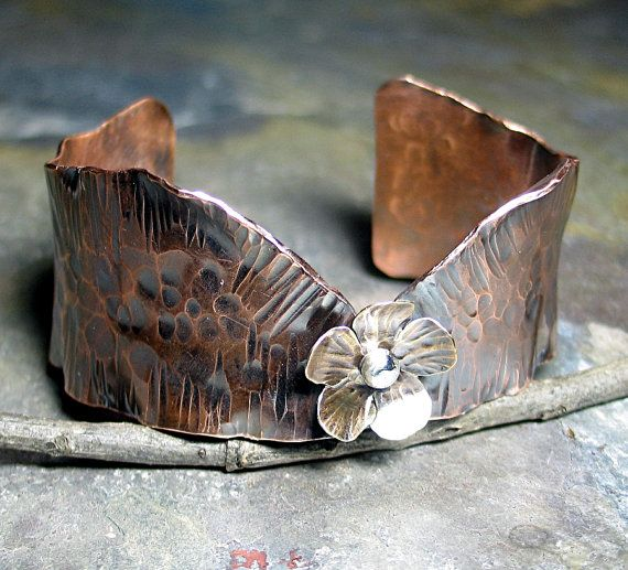 I love working with copper, and this flower cuff is one of my favorites to make!  Lavender Cottage on Etsy