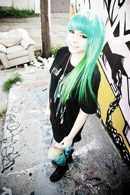 Hipster girl with green hair and galaxy leggings.