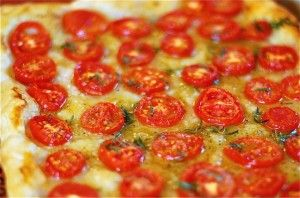 Tomato Tart:     adapted from Canal House Cooking Vº4.     1 sheet puff pastry, defrosted,     2-3 large tomatoes, or a handful of cherry tomatoes, cored and sliced,     2-3 branches fresh thyme,     2-3 T. good quality olive oil,     Pepper,     3-4 generous pinches of Sea Salt.      1. Preheat oven to 375ºF. Line a jelly roll pan with parchment paper or a Silpat. Place the puff pastry on the lined baking sheet and lightly score a 1/2″ border around the edge with a sharp knife. Use fork tines to prick the pastry inside the border all over. This will prevent the pastry from puffing up too much when baking.    2. Place the tomato slices in a single layer on the puff pastry, being careful not to overlap. Strip the thyme branches and sprinkle over the tomatoes, then drizzle with olive oil, a few cranks of good pepper and sea salt.    3. Baked for 30-40 minutes or until pastry is crispy and deeply browned. Sprinkle on a dash more salt. Serve.