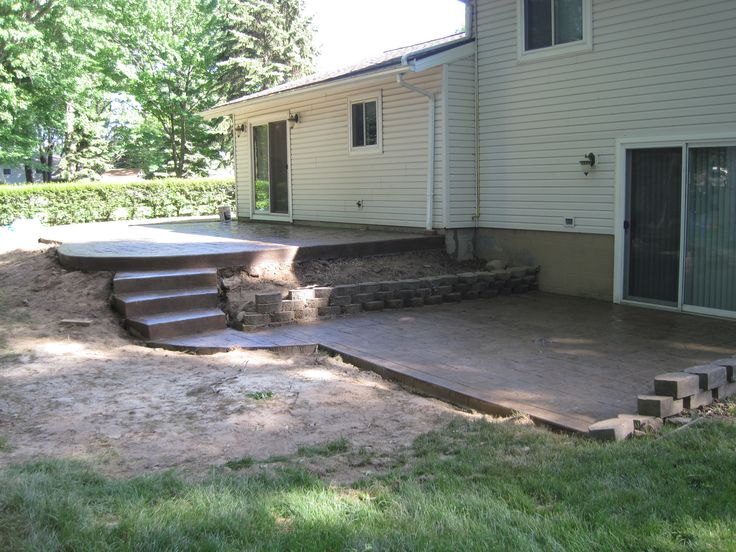 Multi level patio with concrete steps stamped concrete for Garden decking hinckley