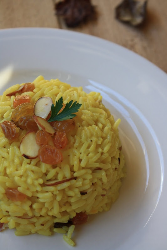 Saffron Rice With Raisins And Almonds Recipe — Dishmaps