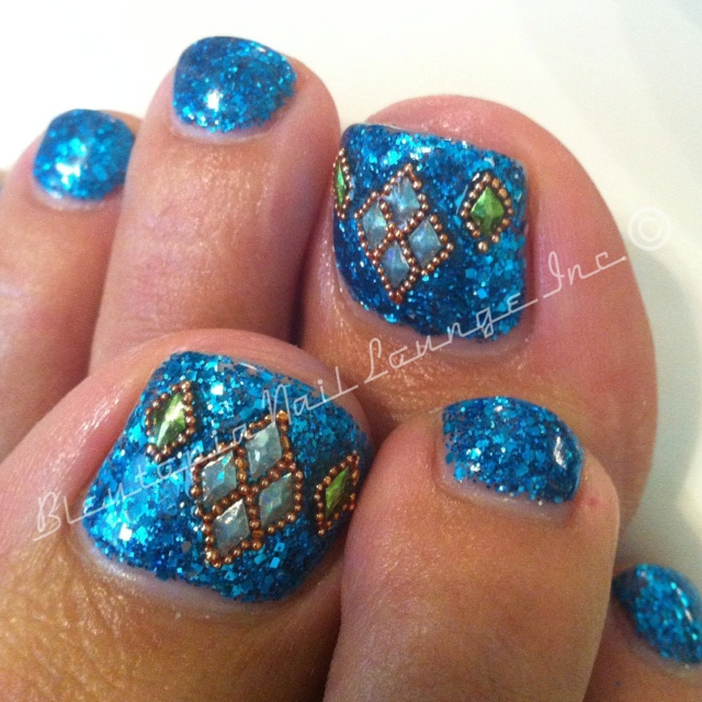 caviar bead detail on turquoise glitter nails