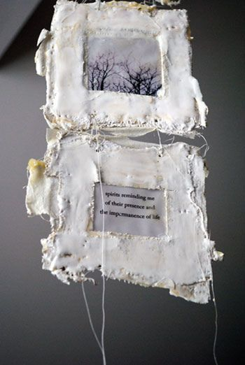 "Spirits (detail), 2010, Bridgette Guerzon Mills, plaster, inkjet prints, encaustic, string, Chicago. ""Right now I am obsessed with incorporating encaustic with paper, and more specifically book art. The combination of wax and paper is really beautiful as the paper absorbs the wax and becomes translucent if the paper is thin. You can also create 3-dimensional forms with paper and wax. ...""Spirits"" was created using plaster, paper and encaustic and is meant to hang like a mobile."""