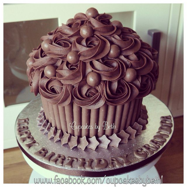 Chocolate Giant Cupcake decorated with Maltesers and Milky Way Magic Stars