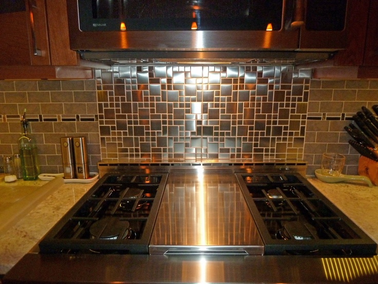 steel backsplash behind stove it looks even better than the photos